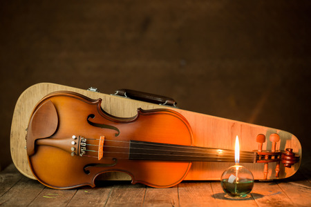 violin with lantern on old steel background,still life