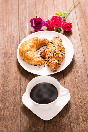 hot coffee and croissant on wooden Stock Photo