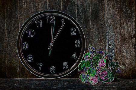 beautiful flower , clock on wooden background.