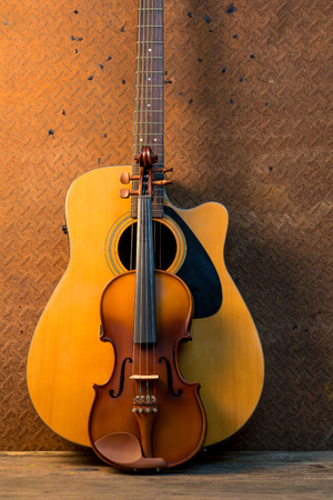 musical score: Acoustic guitar and violin on old steel  background Stock Photo