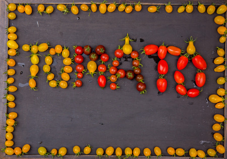 frame of red and yellow tomatoes