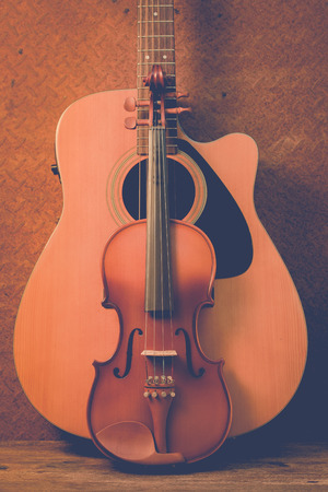 Acoustic guitar violin on old steel  background Stock Photo