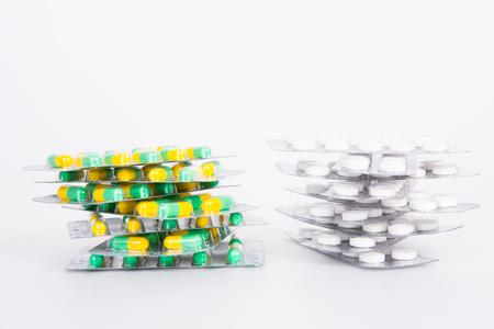 pile of pills on white background Stock Photo