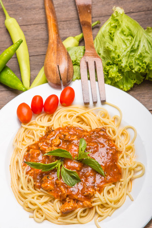plate of Italian spaghetti with fresh tomato served with a leafy green salad