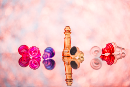 Chess pieces on board on bright background Stock Photo