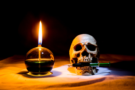 syring: lamp and skull with syring in the dark night, Still life style Stock Photo