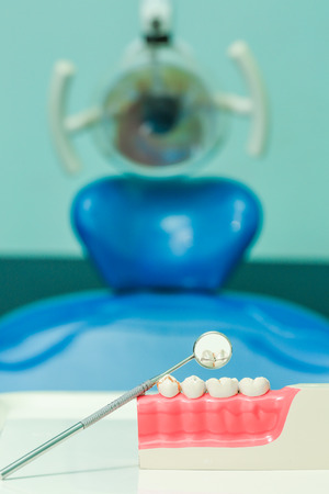 White teeth and dental instruments