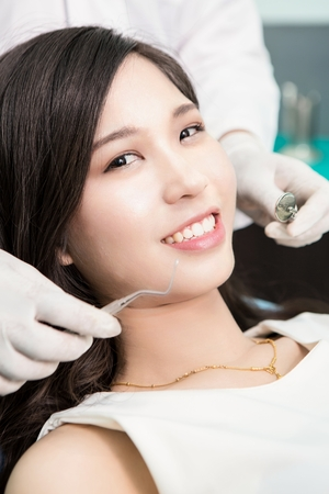 medical office: Dentist examining a patients teeth in the dentist. Stock Photo