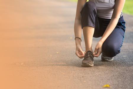 shoelaces: woman Tie shoelaces While jogging