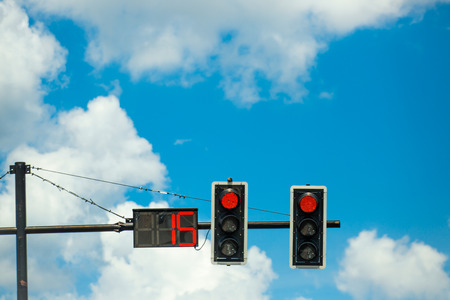 count down: red color on the traffic light with a beautiful blue sky,red color on the traffic light with count down