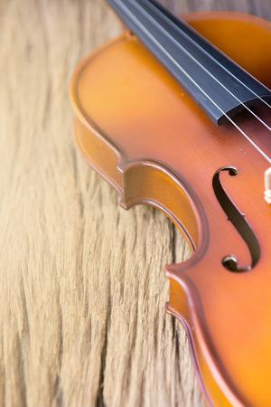 part of violin on wood background,vintage style