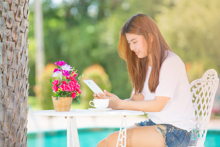thai ethnicity: asia teenager Women  using her tablet.