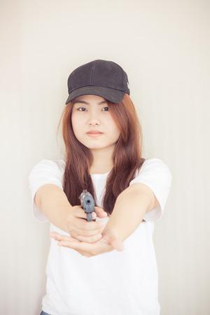 Young asian Woman holding the gun