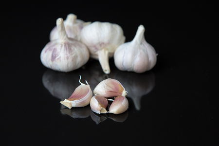 Garlic with reflection on black