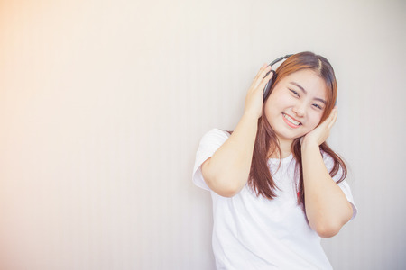 asian young woman enjoying with her music listening