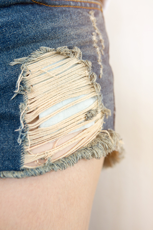 ripped jeans: Closeup of blue  ripped jeans. Stock Photo