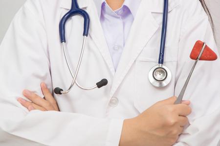 reflex: doctor in coat holding a reflex hammer
