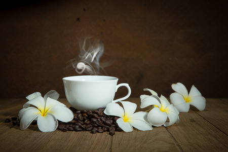 coffee cup and coffee bean on wooden