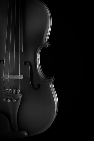 fiddles: Close up of a violin isolated on a black background