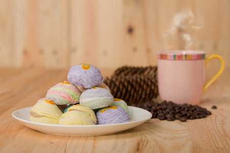 Traditional Chinese cake, Egg yolk shortcake with coffee on wooden Stock Photo