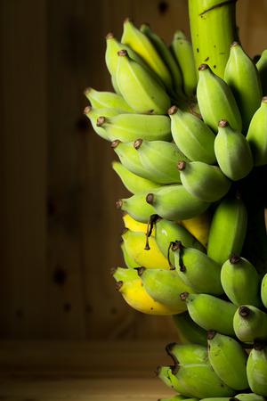 Fresh bananas on wooden background