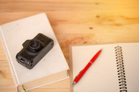 old camera with notebook Stock Photo