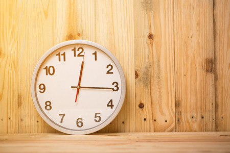 white clock on  wooden background Stock Photo