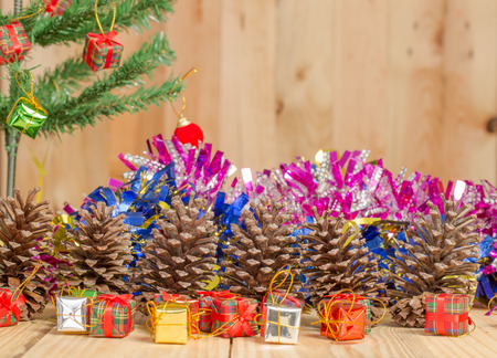merry christmas  ,Christmas tree with gifts on wooden background. Stock Photo
