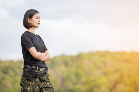 Female soldier on the nature background