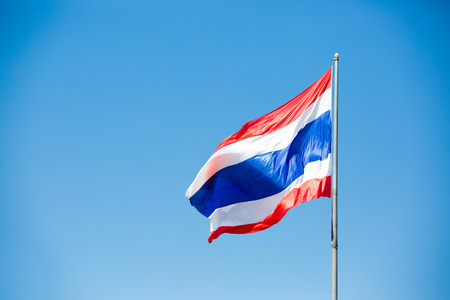 flagstaff: waving Thai flag of Thailand with blue sky background. Stock Photo