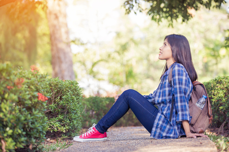 prety: young asian woman relaxing in the park Stock Photo