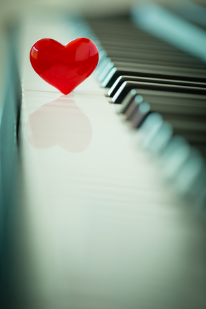 red heart on piano,love concept Stock Photo