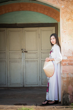 beautiful woman with Vietnam culture tranditional dress, Ao dai