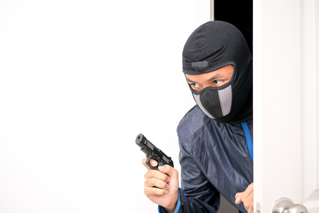 thief with gun entering the room