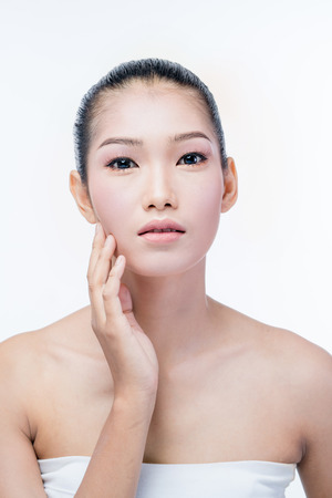 young beautyful asian woman make up on white background