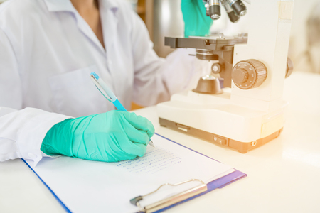 Doctor woman or chemist working  in biology or chemical laboratory with laboratory equipment