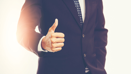Businessman showing thumbs up Stock Photo - 84902406