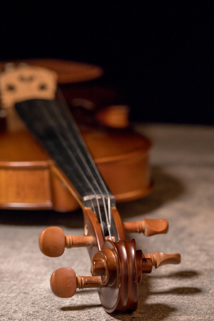 close up head of vintage violine on concrete background
