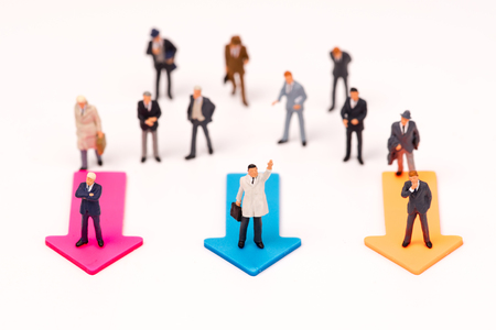 Miniature people,Businessman leader standing on arrow to select way go ahead,business concept