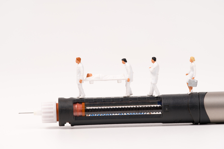 miniature health care team and medical tool,insulin pen and glucometer Zdjęcie Seryjne