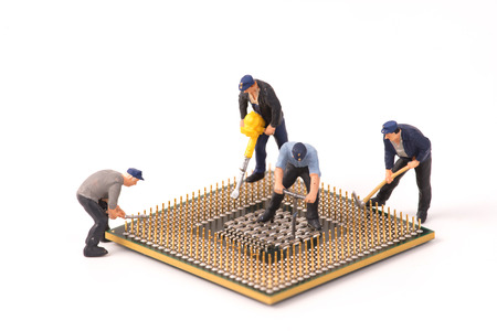 miniature people repair cpu board,teamwork and technology concept