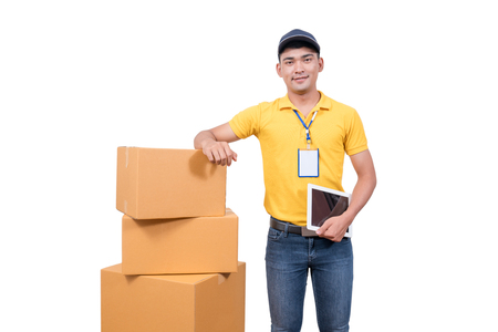 delivery asian man. Happy young courier holding  box and smiling on white background