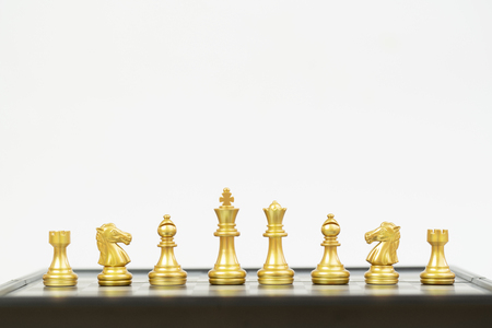 golden chess piece on white background
