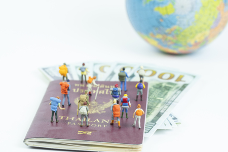 miniature backpacker with passport and dollar banknote,tourist concept