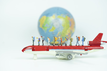 miniature backpacker with airplane and globe,tourist concept