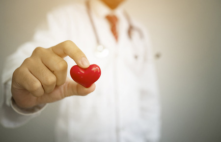 doctor holding red heart shape,healthcare concept