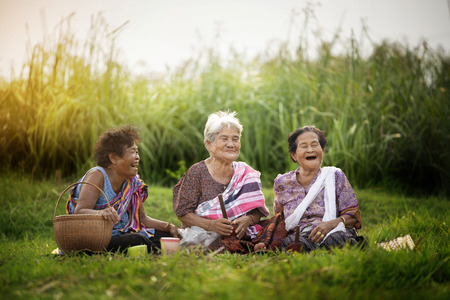 Happy asian woman with rural scene Stock Photo