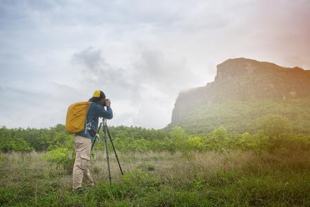 Photographer take photo with mountain background