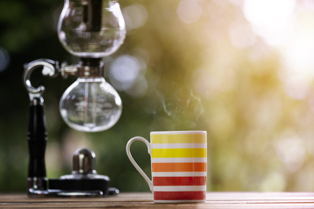 colorful cup of coffee  with nature background