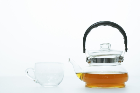 tea cup and tea pot on white background